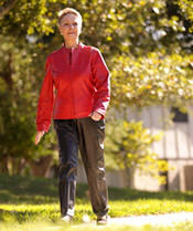 Image of senior woman in athletic clothing taking a walk