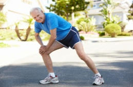 Image of mature man stretching for a run - click for more information about total hip replacement surgery